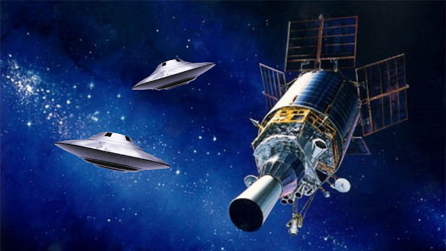 An official USAF rendition of a DSP satellite, which are in orbit around Earth but I added the Flying Saucers.