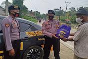 Polres Serang Bagikan 50 Paket Sembako kepada Warga Terdampak Covid-19