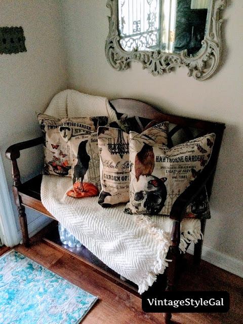 Vintage Halloween Art pillows on bench in foyer