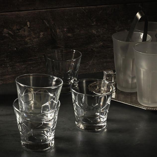 Duralex glasses on dark wood surface