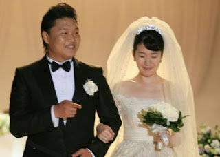 Yoo Hye-yeon with her hubby PSY in their wedding dress