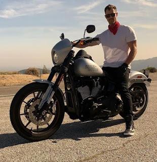 Lauren Kutner's husband Jason Dohring sitting in a bike