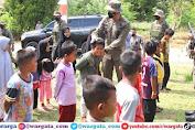 Kunjungi Pos Sekat Tamanjeka, Kapolda Sulteng Disambut Dengan Anak-Anak Dusun