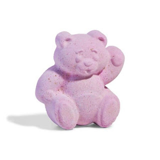 A animated pink bear shaped bath bomb on a bright background