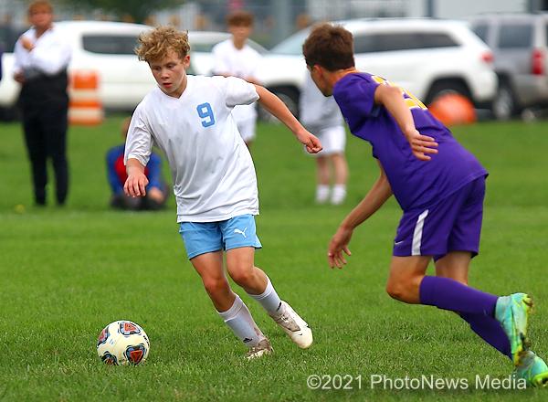 Logan Mills dribbles the ball
