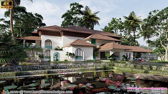 Thamarakulam (lotus pond) in front of traditional Kerala home