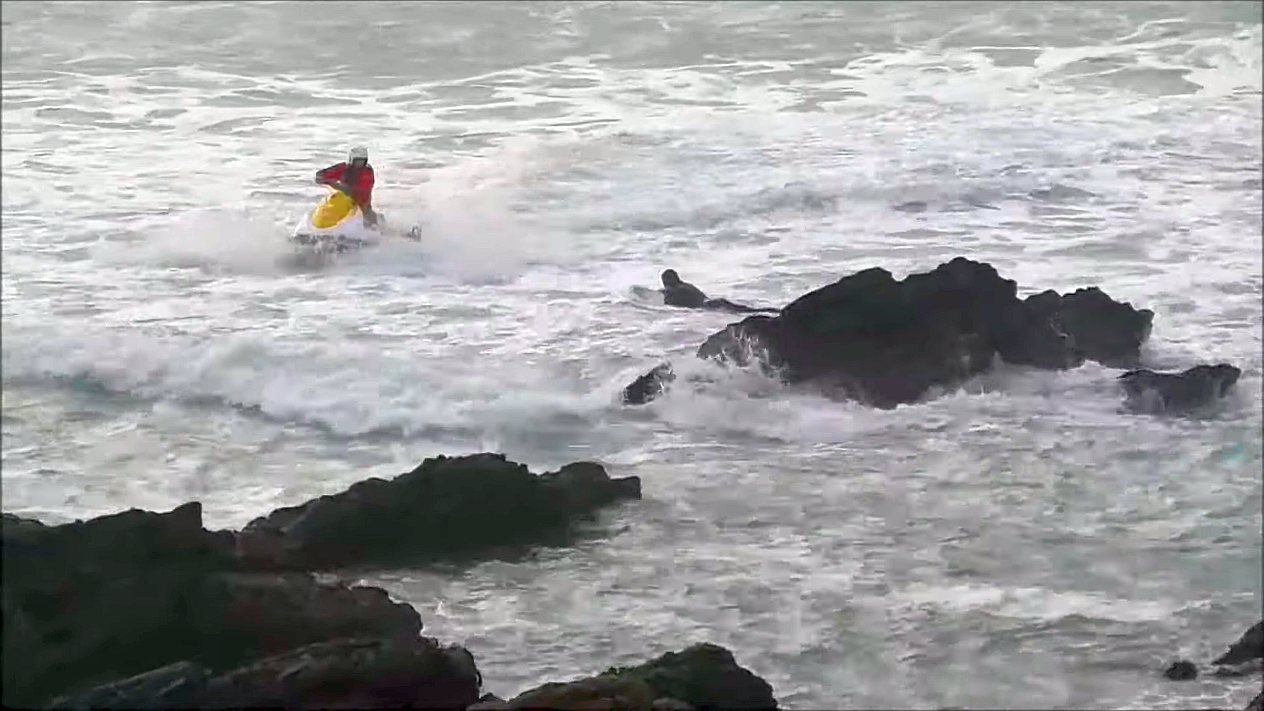 Rescue Surfers washed into rocks by rip current Newquay