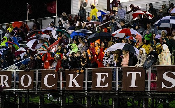 Unity student fans tolerate the rain