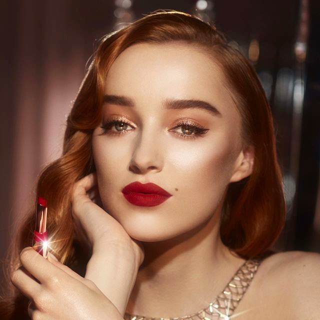 Phoebe Dynevor oozes Hollywood glamour with a sultry red lip as she poses for radiant Charlotte Tilbury shoot after landing deal with the makeup brand