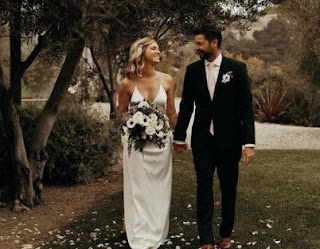 Cindy Busby with her husband Chris Boyd in their wedding dress