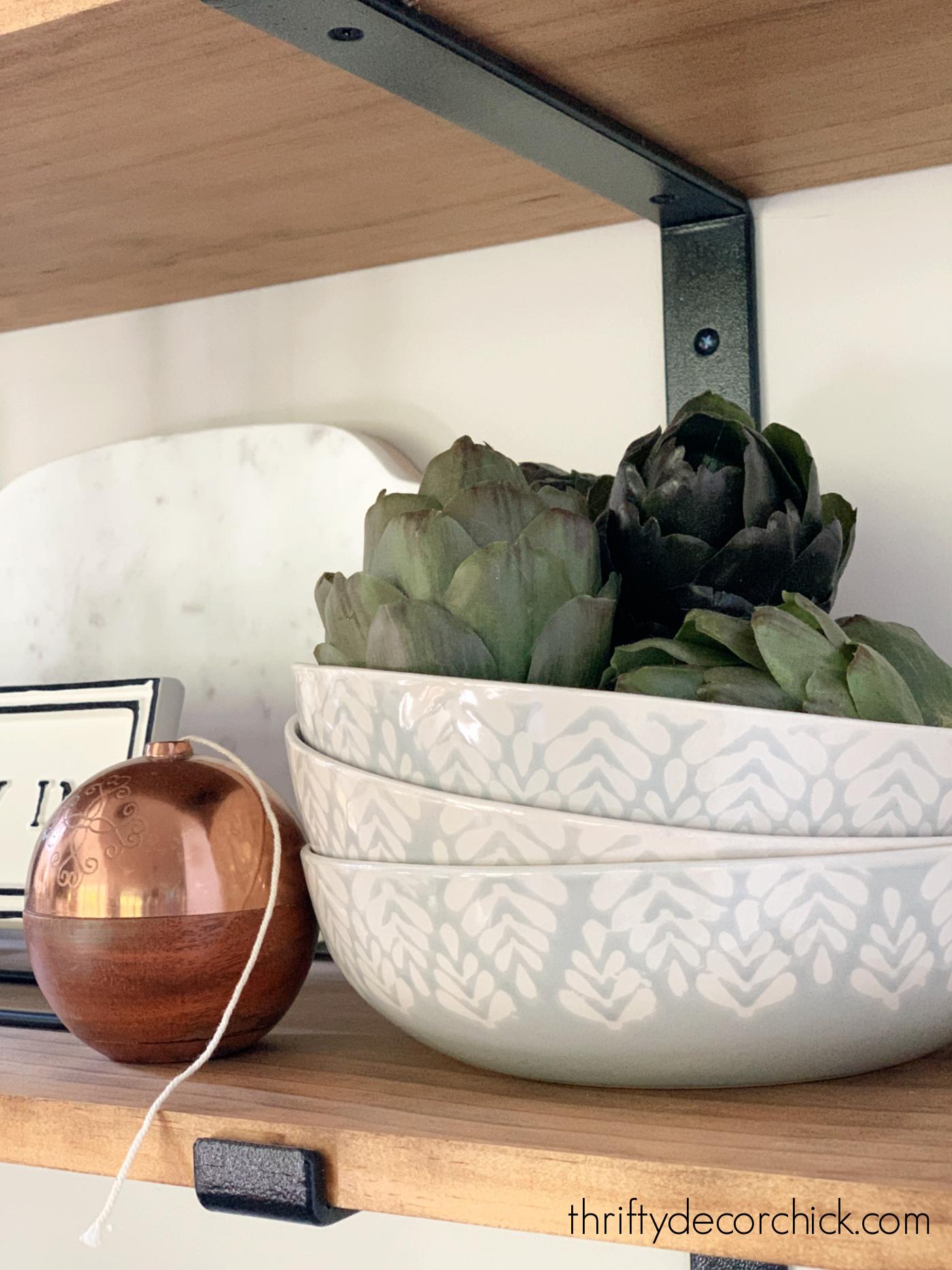 Faux artichokes in bowl