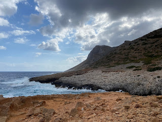 Views of Katholiko Beach, more of a cove, under stormy skies.