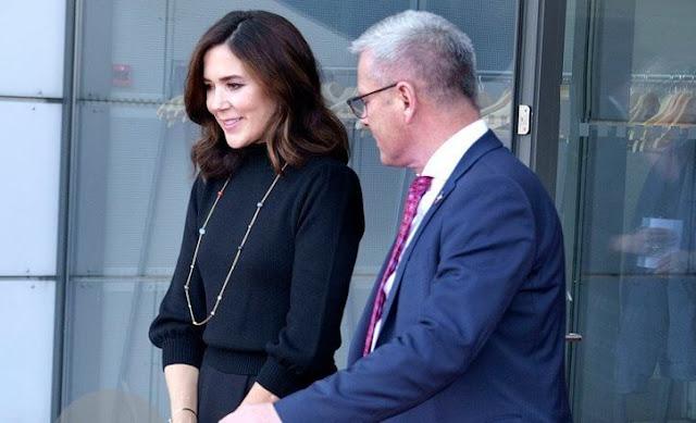 Crown Princess Mary wore a wool sweater by Co. Dulong delphis earrings and esme bracelet. Rebekka Notkin bracelet