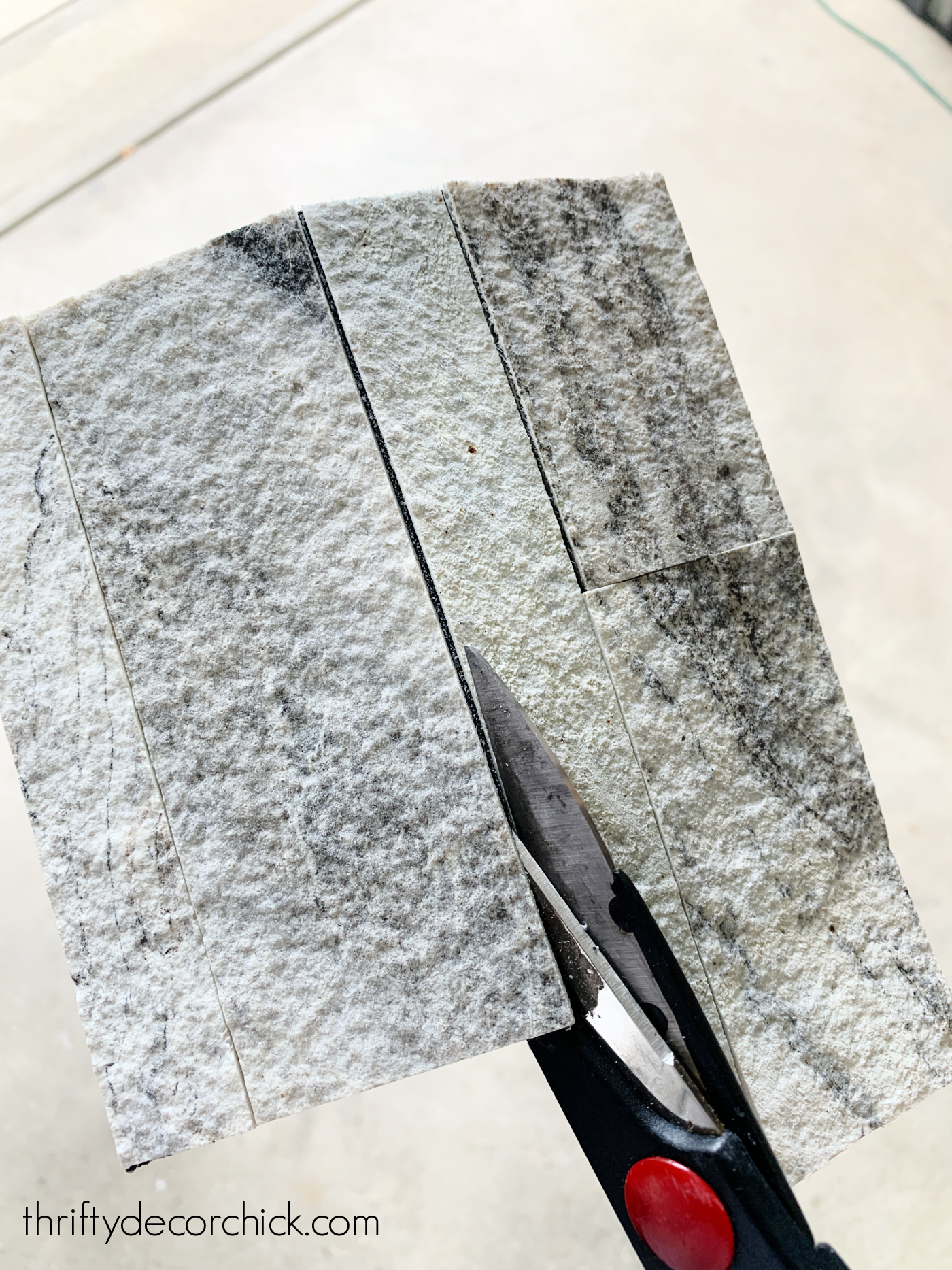 cutting stone peel and stick tile