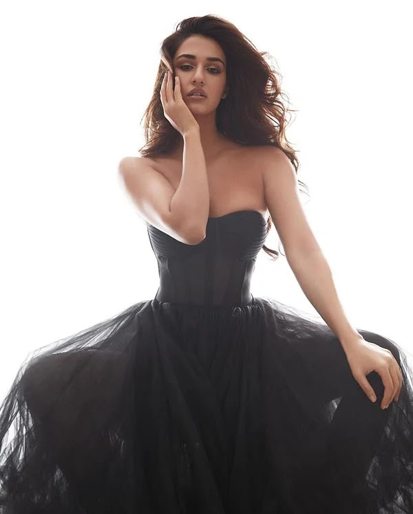 Disha Patani raises heat in this cleavage baring off shoulder black dress