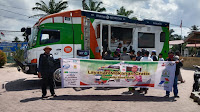 Operasi Makan Gratis di Gelar ACT-MRI Aceh Tamiang di Lapangan Tribun Dengan Food Truck