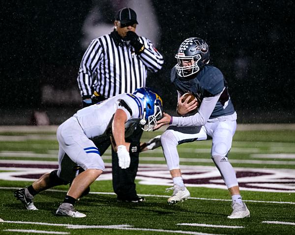 Blake Kimball avoids a Panther tackler