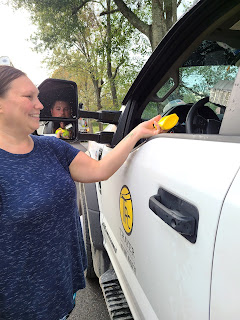 Dari Richardson offers mustard to a line worker.