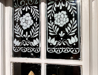 painted lace on window pane