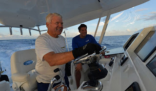 Rookmaaker's spouse Johnson driving a boat