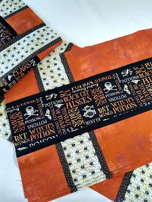 Halloween patchwork using black, cream and orange prints
