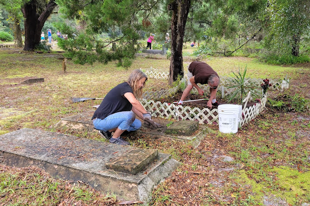Diane Woinski and husband cleaning out Petronilla and Vondalyn Clark's graves