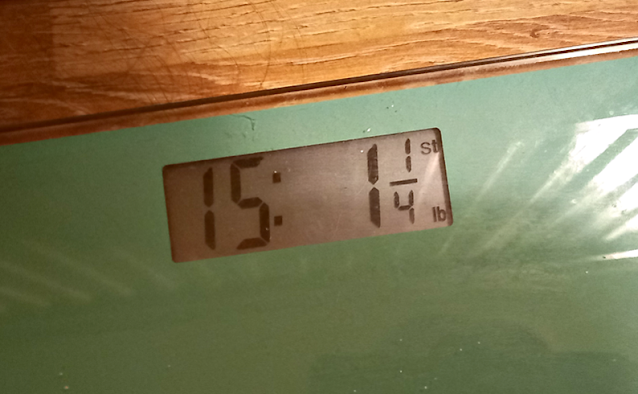 My weight on the scales. 15st 1.