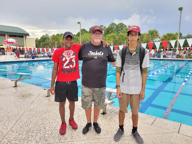 SAHS Swim Coach Frank Holleman with former swimmers Germari Rickerson and Roshane Rodney