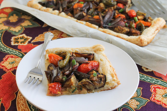 Food Lust People Love: This golden briami tart features eggplant, onion, tomatoes, bell pepper and, of course, garlic, pan-fried till golden then baked in puff pastry crust.