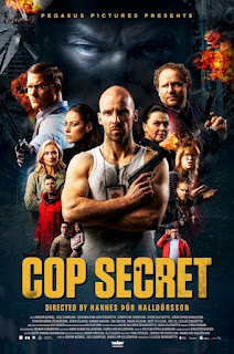 Film poster cast around main character in white vest