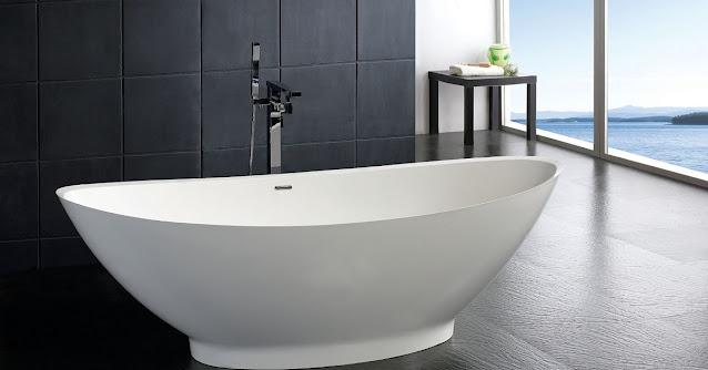 Neptune bathtub in a gray bathroom.