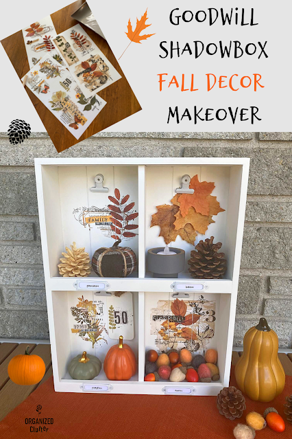 Photo of an upcycled thrifted shadowbox decorated with decor transfers and filled with fall mini decor.