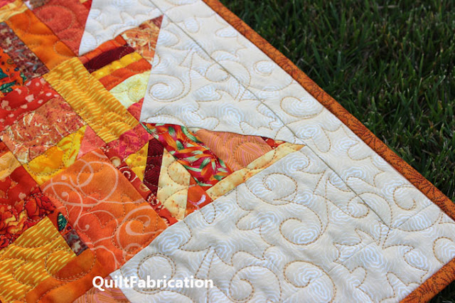 gold quilting on a maple leaf