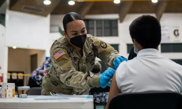 A resident is vaccinated at the UOG Fieldhouse Immunization Center, Guam. Photo: The Guardian