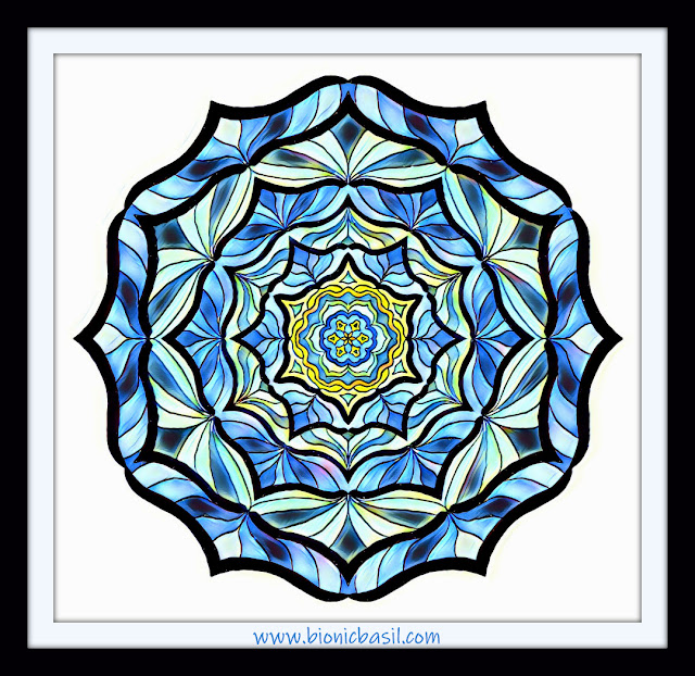 beautiful mandala coloured in shades of blue, blue kaleidoscope mandala