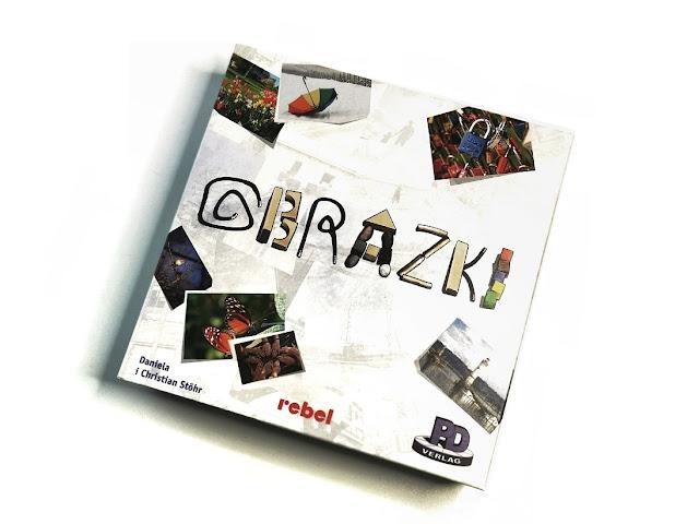 pudełko gry obrazki z nadrukowanymi na okładce przykładowymi ilustracjami z gry