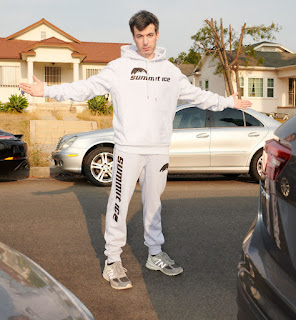Sarah Ziolkowska's ex-hubby Nathan Fielder posing for picture with car in the background