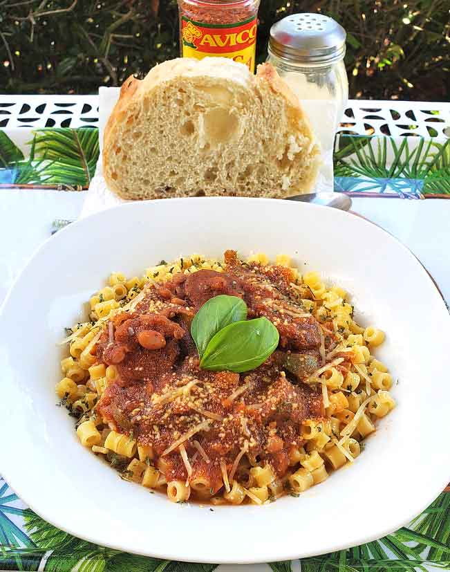 this is white beans, sausage, tomato sauce and pasta