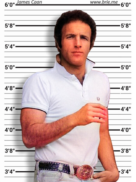 James Caan standing before height chart background