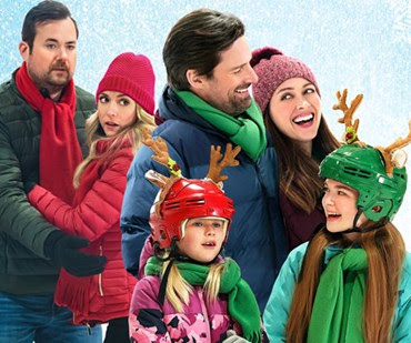Amy Acker and Warren Christie star in Crashing Through the Snow, which premiered during Hallmark's annual Christmas in July 2021 celebration. Image: Crown Media