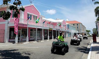 Tourists driving ATVs through town