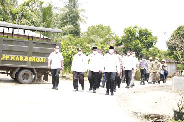 Resmikan Jalan Desa Kuta Pinang, Bupati Sergai Meminta Agar Masyarakat Merawatnya