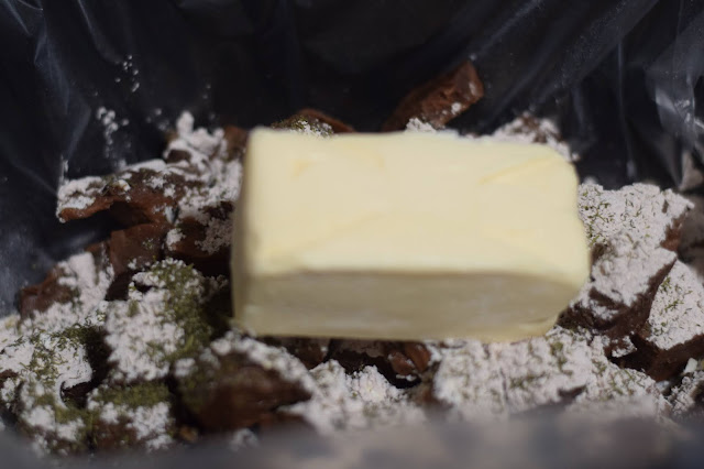 A stick of vegan butter placed in the crock pot.