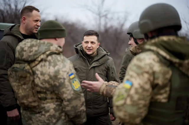 President Volodymyr Zelenskyy (centre) during a visit to the Ukrainian Army in Donbass. Photo: Reuters