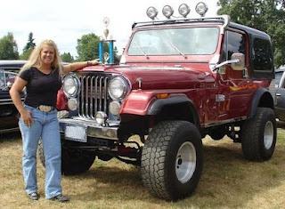 Joseph Jens Price's Tonya Harding posing for photo with award & Jeep