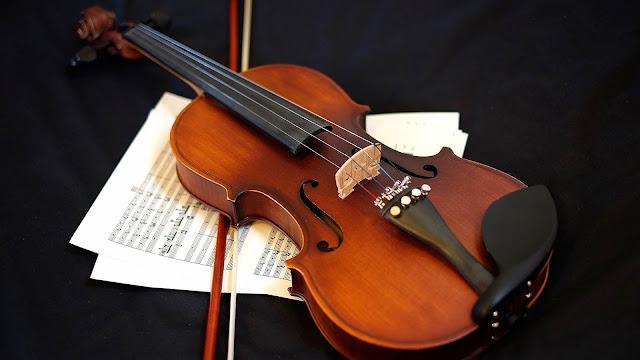 Table violin and sheet music wallpaper