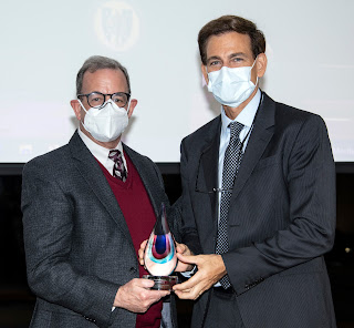 Dr. Paul Pasquina, chair of USU's Department of Physical Medicine &  Rehabilitation, accepts an achievement award at a town hall meeting Sept. 23, 2021. (Photo courtesy of Tom Balfour, USU)