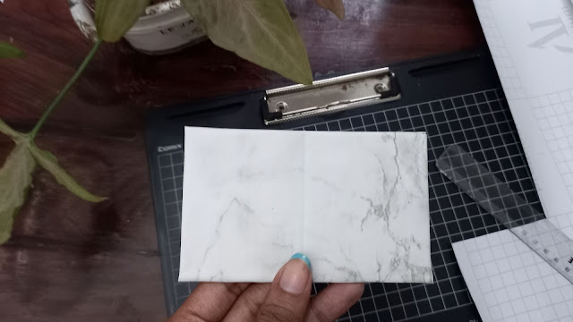 The base covered in contact paper