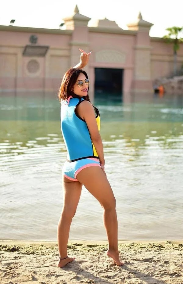 Neha Malik in blue bikini flaunts her sexy body - see latest hot photos of this Indian model.