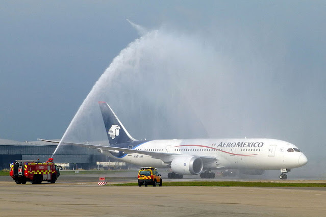 plane,water salute,water,water cannon,mauritius plane spotter,water salut,father james martin sj,welcome,waterbombs,rafale latest news,landing,airplane,helicopter,watercannonsalute